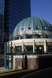 The domed building in front of the tower has a fitness center.(Jim Tuttle - Staff Photographer)