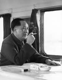 "ORG XMIT: *S0417757667* (FILES) This file photo dated 1961 shows former Chinese leader Mao Zedong enjoying a cigarette as he travels in 1961 in his train in Lushan Mountain. The Chinese official agency distributed this picture in September, 1976 after Mao's death with the title ""Great leader Chairman Mao will live forever in our hearts"".  China will mark 09 September, 2006 the 30th anniversary of the death of the great Chairman Mao, who despite being the architect of the Cultural Revolution that killed millions and took China to the brink of collapse, is still revered by many across China as a god-like figure.   AFP PHOTO/XINHUA/FILES  (Photo credit should read AFP/AFP/Getty Images) HKG64405"