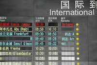 The arrival board at the International Airport in Beijing shows a Malaysian airliner is delayed from Kuala Lumpur.(Ng Han Guan - AP)
