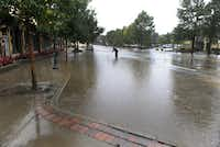 Flood waters are still over-flowing on to E. Elkhorn Ave. As a steady rain continues to fall, the town of Estes Park, Colo., Sunday Sept. 14, 2013 begins to clean up the flooded downtown streets and stores that are popular for visitors.