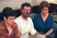 Beck Weathers was joined at a news conference upon his return from Everest to Dallas by his son, Beck, and his wife, Peach. He faced several operations to amputate his right hand, fashion a mitt from his left hand and create a new nose.(1996 File Photo - Staff)
