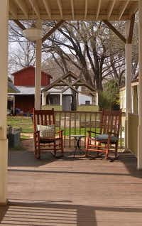 Guests often choose to knit or read on the sunny back porch at Hotel Faust in Comfort.( Photos by Helen Anders  -  Special Contributor )