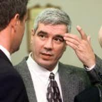Kerry Max Cook conferred with his legal team in Bastrop in 1999.