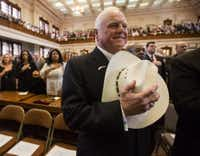 Commissioner of Agriculture Sid Miller holds his cowboy hat over his heart in January during the singing of the national anthem during the first day of the 84th legislative session at the Texas Capitol. (Ashley Landis/The Dallas Morning News)