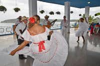 Left:  Adonia passengers enjoyed lunch and a dance performance at Punta  Gorda restaurant in  Santiago de Cuba.(Wesley Teo - Special Contributor)