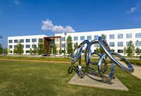 A stainless steel sculpture in the office park at Billingsley Co.'s Cypress Waters development.( Peter A. Calvin  - ©2015 Peter A. Calvin)