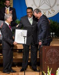 Dwaine Caraway says goodbye to Dallas City Manager A.C. Gonzalez and Dallas Mayor Mike Rawlings at Monday's swearing--in of the new Dallas City Council. (Ashley Landis/Staff photographer)