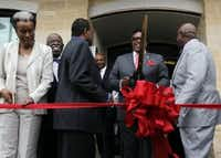 Dwaine Caraway, second from right, with a giant pair of scissors before he had an officer detailed to him on June 12, 2014. The event was a ribbon cutting ceremony at the new Lancaster Urban Village apartment and retail complex in South Dallas to celebrate its opening. (Mona Reeder/The Dallas Morning News).