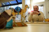 Anthony Carrillo, 85, makes stained-glass figurines in the craft room at Chambrel at Club Hill retirement home in Garland. Carillo started making stained glass figurines as a hobby more than 20 years ago. However, after about a seven-year break from his hobby, he decided to build a nativity set made from stained glass for his retirement home.Photos by ROSE BACA