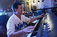 Keyboardist Bryan Dunklin of The Catdaddies rehearses with other band members. The musicians are in the midst of writing and recording their own music. So far, they've written about eight songs and recorded two.Rose Baca - neighborsgo staff photographer