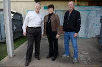 Cedar Hill High School alumni (from left) Joe Pitt, Sandra Barber and Johnny Krueger stand outside what used to be the front entrance to their high school before it was vacated and turned into the district's administration building in 1978. The building, opened in 1957, will be demolished to make way for a projected $2.47 million, 318,000-square-foot baseball/softball facility.( ROSE BACA/neighborsgo staff photographer )