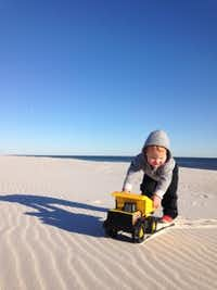 Chapel Kendrick plays on the beach during his family's yearlong road trip around the country.