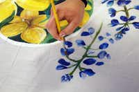 Angie Reisch paints a bluebonnet on a mural meant to show solidarity between Charleston, S.C., and Dallas.(Michael Reaves - Staff Photographer)
