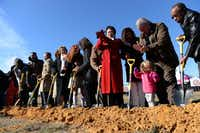 School officials and family members participate in a ceremonial groundbreaking for International Leadership of Texas' new charter school campus in Garland on Jan. 29, 2014. The new high school campus will also host 192 Chinese exchange students this upcoming school year.ROSE BACA/neighborsgo staff photographer