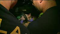 Firefighters use a special mask to administer oxygen to a dog rescued from a burning home in Dallas.NBC5 screencap