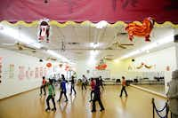 Asian women participated in a line dancing class on Feb. 11 at the Dallas Chinese Community Center in Richardson. According to the U.S. Census Bureau, Asians comprised more than 15 percent of the suburb's population in 2010.(Photos by <TypographyTag12>Rose Baca</TypographyTag12>)