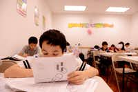 Ian Margolis completes a lesson at HuaYi Education, a Chinese school offering supplemental education and after-school programs for many of Plano's Asian students. There is supervised homework, lessons in Chinese language, math, reading and chess programs.
