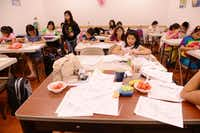 Students do school work at HuaYi Education, a Chinese school offering supplemental education and after-school programs for many of Plano's Asian students. There is supervised homework, lessons in Chinese language, math, reading and chess programs.