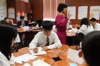 Shen leads her class of Chinese exchange students in a lesson at IL Texas charter school in Garland.(Rose Baca - neighborsgo staff photographer)