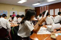 Chinese exchange student Yu Qinyue works on an assignment in her Chinese language class at the International Leadership of Texas charter school in Garland.(Rose Baca - neighborsgo staff photographer)