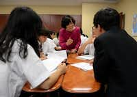 Chinese language teacher May Shen talks to Chinese exchange students during a lesson at the International Leadership of Texas charter school in Garland. The district's Garland campus will play host to 27 Chinese high school students, who will be housed in a dormitory behind the newly constructed $20 million high school at the southwest corner of Arapaho and Shiloh roads.( Photos by Rose Baca  - neighborsgo staff photographer)