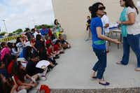 Chinese language teacher Alice Tsui directs fourth-graders during the Chinese Dragon Boat Festival at R.E. Good Elementary School.(Rose Baca)