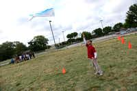 Abraham Compas flies a kite as part of the activities for students during the festival.Rose Baca
