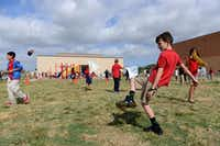 Fourth-grader Jake Hrbacek plays hacky sack during the Chinese Dragon Boat Festival at R.E. Good Elementary School in Carrollton. Students are learning Chinese through the school's International Baccalaureate Primary Years Programme World School status.( Photos by Rose Baca/Neighborsgo staff photographer )