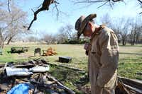 Chris Mayes stands in his backyard among scraps of wood he uses for his wood projects at his home in Nevada, Texas. Mayes grew up working with his hands as a mechanic, but it wasn't until he retired that he recognized his talent for woodworking.(Rose Baca - neighborsgo staff photographer)