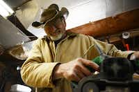 Mayes reacts to sawdust in his eyes while sanding wood for a mission-style chair he is working on in his backyard wood shop in Nevada. Mayes grew up working with his hands as a mechanic, but it wasn't until he retired that he recognized his talent for woodworking.Rose Baca - neighborsgo staff photographer