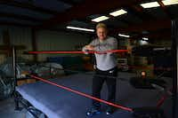Rob Vaughn,  the founder of the Christian Wrestling Federation, stands in the ring inside his training facility in Balch Springs. The group, based in the Rockwall area, blends professional grappling with Christian ministry.(ROSE BACA)