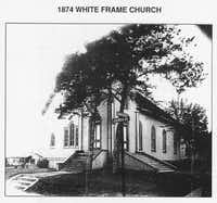 The original white frame Trinity Presbyterian Church was built in the early 1870's at the corner of Church and Davis streets near the downtown square of McKinney.