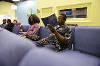 Kenneth White, a shelter resident, reads the Bible before an evening service at CitiChurch. Pastor Ferguson aims to use the money from the consignment shop, Design on a Nickel in the Bishop Arts District, to open a daytime resource center for the homeless with individual shower stalls, mailboxes, computers and washers and dryerss.(Rose Baca - neighborsgo staff photographer)