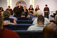 Pastor Jeff Ferguson leads a service for the congregation, which includes the homeless from Austin Street Center, at CitiChurch of Dallas.( Rose Baca  -  neighborsgo staff photographer )