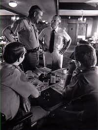 Bill Clements talks to DPS officers in Victoria, Texas while campaigning in August 1978.