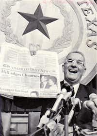 """Bill Clements holds up a copy of The Amarillo Daily News bearing his own version of the Dewey-Truman headline.  The newspaper wrongly proclaimed """"Hill edges Clements"""" on Nov. 8, 1978."""