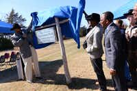 Sean Johnson, director of parks and recreation for the city of Lancaster, and Cleo Hearn (right) unveil the sign at the recently named trailhead of the Cleo Hearn Equestrian Trail.(Rose Baca - Neighborsgo)