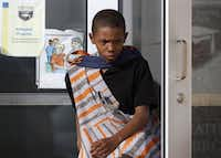 <p>Demarquis Brooks, 10, a fifth-grader, shed tears as he left Prime Prep Academy's Fort Worth campus on the afternoon it closed. The school was shut down after officials determined it was financially insolvent. (Rose Baca/Staff Photographer)</p>