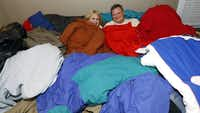 Andrea Anglin and Mike Bulin pile up the coats for teenagers who are on their own after growing too old for foster care. They spread the word through social media and have collected about 280 coats this year.
