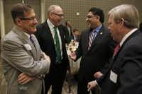 From left: Ronald Brown of UNT-Dallas, Neal Smatresk of UNT, Vistasp Karbhari of UTA and Joe May of Dallas County Community College District talked Thursday before the Dallas Regional Chamber luncheon at Westin Galleria Dallas.( Nathan Hunsinger  -  Staff Photographer )