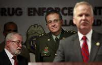 Gen. Oscar Naranjo, Colombia's national police chief at the time, listened as John M. Bales, U.S. attorney for the Eastern District of Texas, announced the federal indictments.( 2010 File Photo  -  Staff )