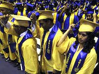 Daisy Zagal (far right) and other Emmett J. Conrad High graduates switched their tassels at the end of commencement June 4 at the Loos Field House.