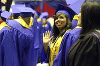 Liliana Lopez waved at her parents during the commencement for Emmett J. Conrad High School's Class of 2011 at the Loos Field House on June 4.