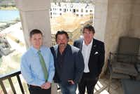 Michael Quint (left), George Fuller and Jeff Blackard stand in the Adriatica Village bell tower, which overlooks the new construction at the project. The three, plus David Brooks (not pictured), have worked together for years to continue development at the site.