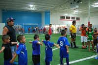 Team members of the Raiders indoor soccer team stand in line after their game on Tuesday night at Garland's Indoor Soccer Zone.