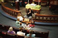 Elaine Tricoli speaks to children in the congregation during last Sunday's service. The lesson was that no one should judge another for being different.(Staff photos by TAYLOR DANSER - neighborsgo)