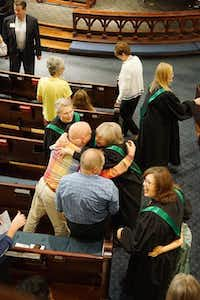 Passing of the peace at OLUMC involves more hugs than handshakes around the sanctuary.( Staff photo by TAYLOR DANSER  -  neighborsgo )