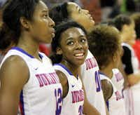 Duncanville senior guard Tasia Foman (second from left) beams with joy as she glances toward senior guard Ariel Atkins as the team awaited their winning medals after defeating San Antonio Wagner in the Class 5A girls basketball state semifinals Feb. 28, a day before the Pantherettes' 105-game winning streak would end at the hands of Manvel.Photo submitted by STEVE HAMM  -  DMN special contributor