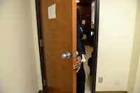 Client Margie Jackson leaves the room after being interview to receive aid from Oak Cliff Churches for Emergency Aid on Nov. 19 in Dallas.