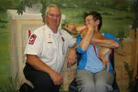 Lily gets feisty with Lancaster Fire Chief Thomas Griffith and volunteer Rusty Lemley.